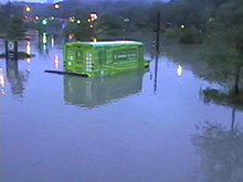In three feet of water, the popular Evergreen shuttle bus looks more like a boat!