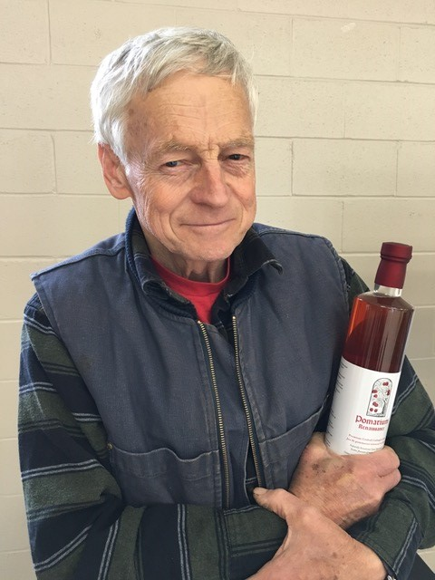 vendor holding bottle of crabapple juice