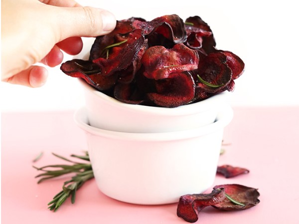 Baked beet chips in a dish.
