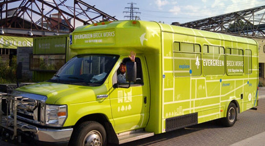 The Evergreen Brick Works Shuttle Bus in front of the Evergreen Garden Market.