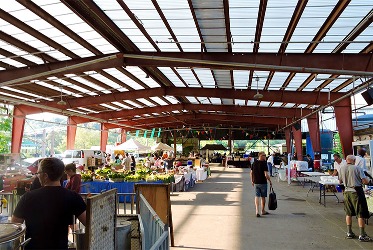 The Saturday Farmers Market at 7:45am. Image credit: Jim Felstiner.