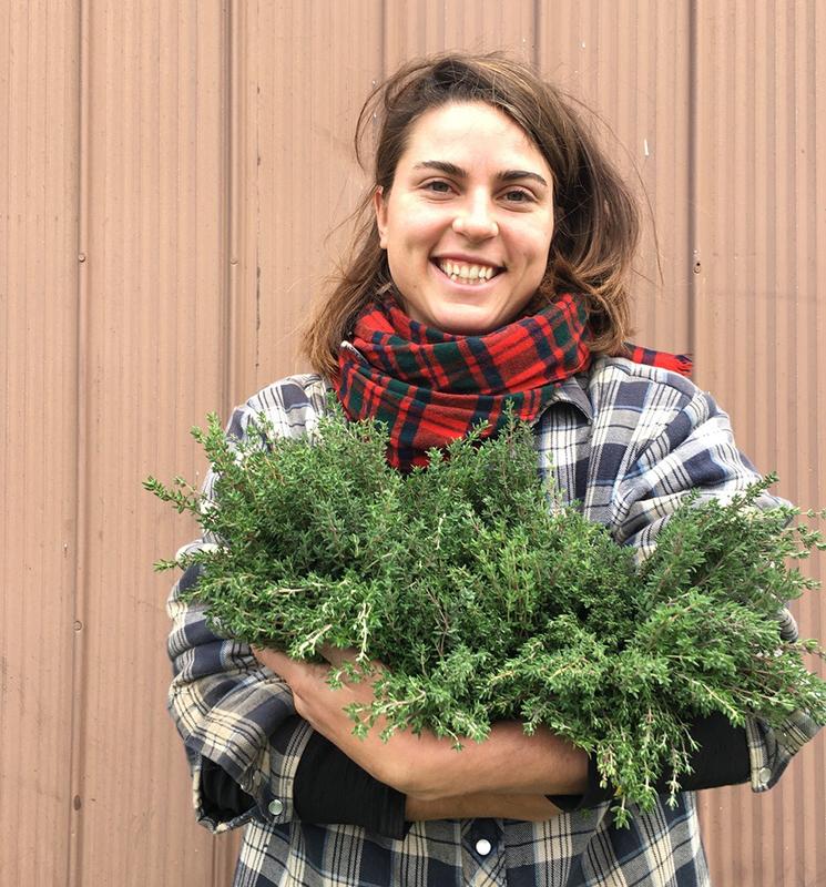 Angelina holding herbs