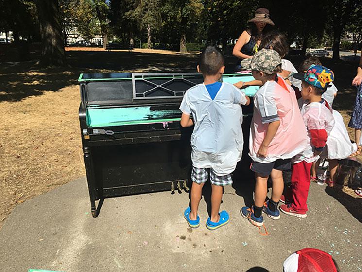 Children painting a public piano in Kensington-Cedar Cottage neighbourhood.