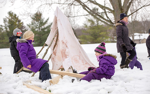 Kids playing outside in winter