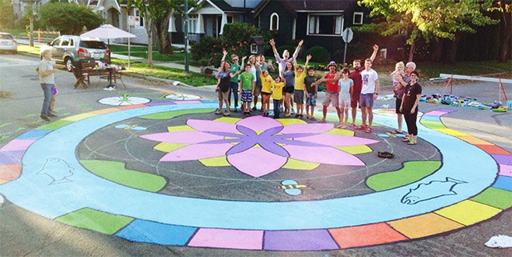 Children posing by the Riley Park mural.