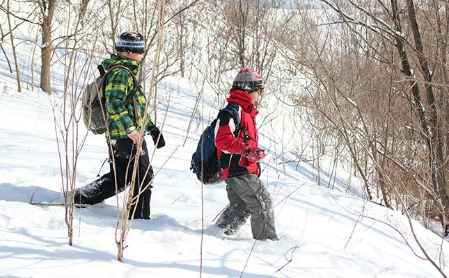 Children walking along a snowy path.