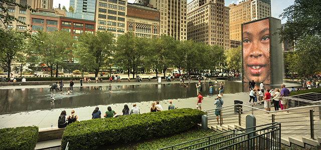 Millenium park - fountain and people playing in water, standing around