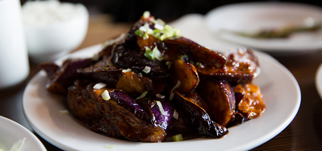 eggplant dish prepared on plate with rice