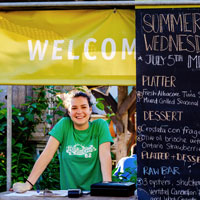 A volunteer at the order station for Summer Wednesdays at Evergreen Brick Works. Image Credit: Andrea Gimblett