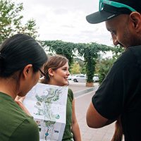 Volunteers showing a trail map at Ravine Days at Evergreen Brick Works