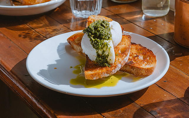 plate with poached egg on bread