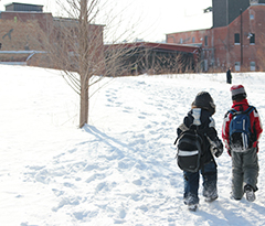 Children walking through snow