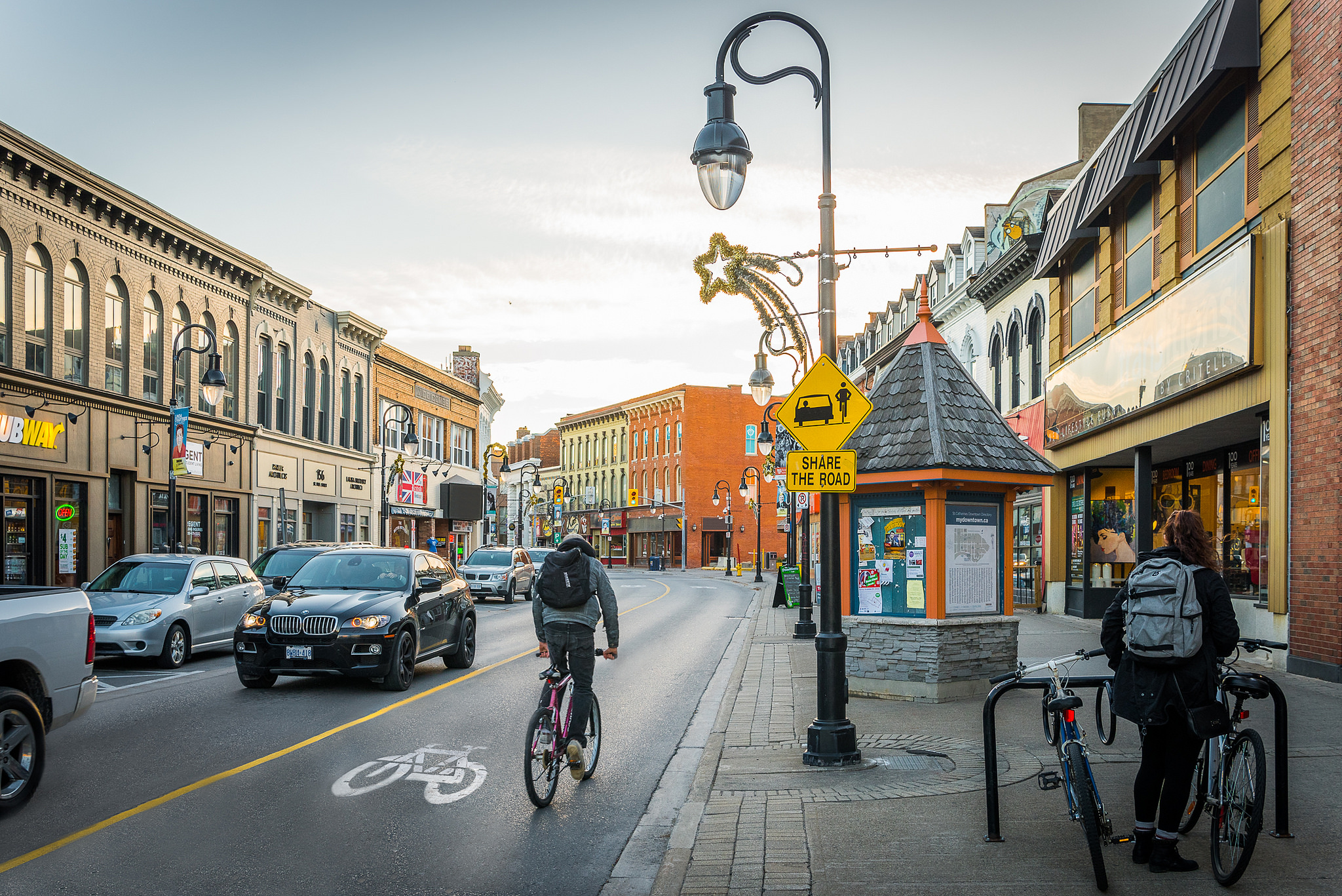A person cycles through St. Catharines, Ontario. Image: Copyright Queen's Printer for Ontario, photo source: Ontario Growth Secretariat, Ministry of Municipal Affairs.