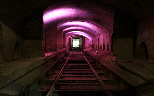 A tunnel lit with pink light