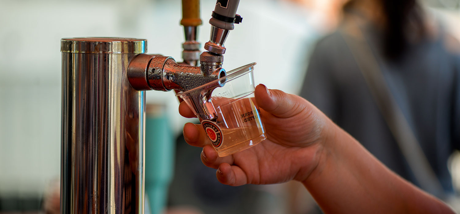Brickworks Cider being poured from a tap at the Harvest Apple Festival at Evergreen Brick Works. Image: Al Yoshiki
