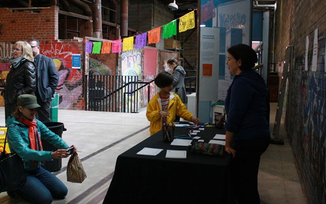 A child speaks to a person behind a booth