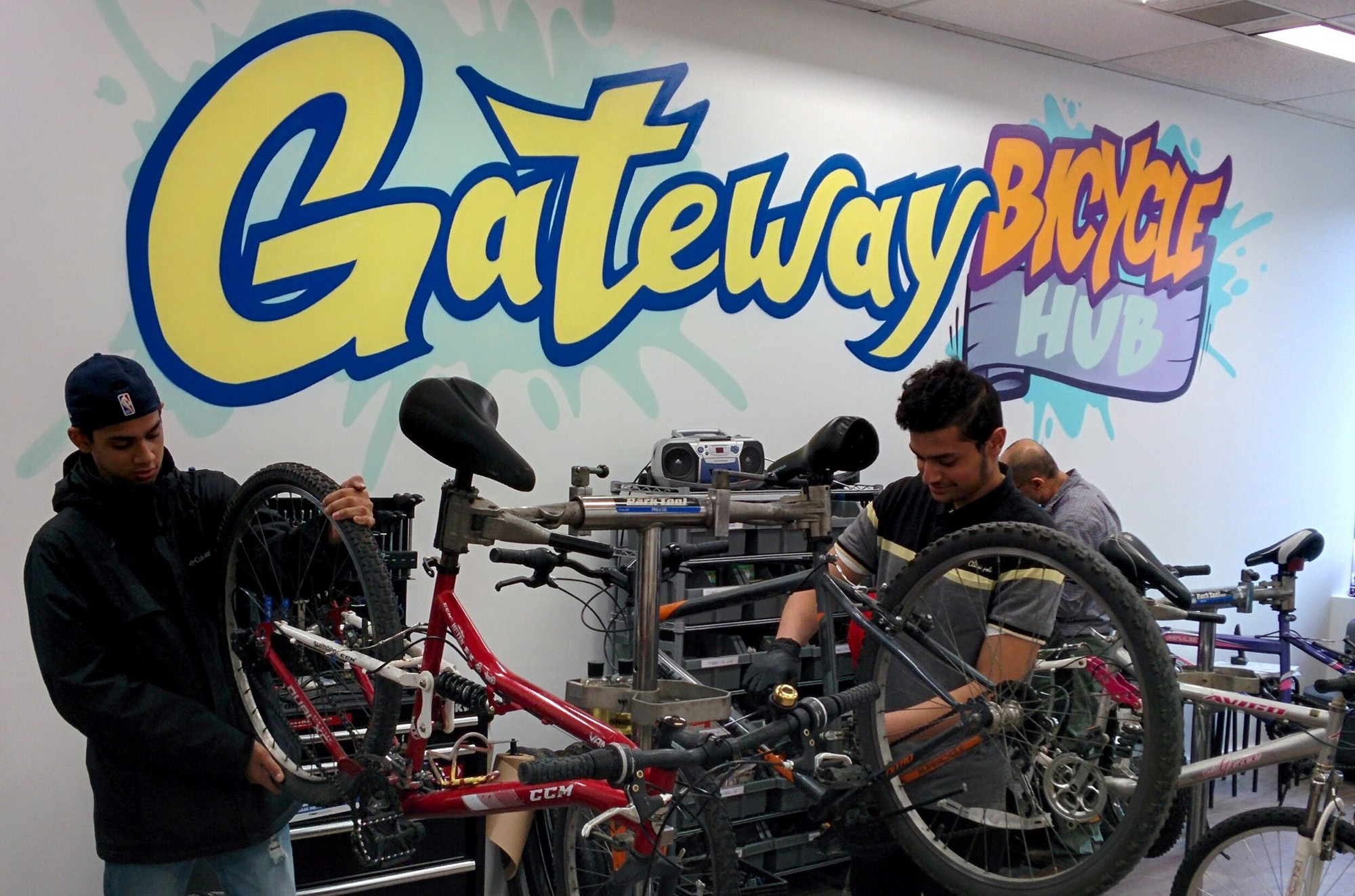 Two people work on bikes at the Gateway Bicycle Hub in Toronto.