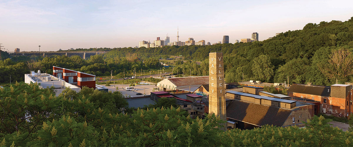 A wide-angle image of Evergreen brick Works overlooking a view of Toronto's skyline.