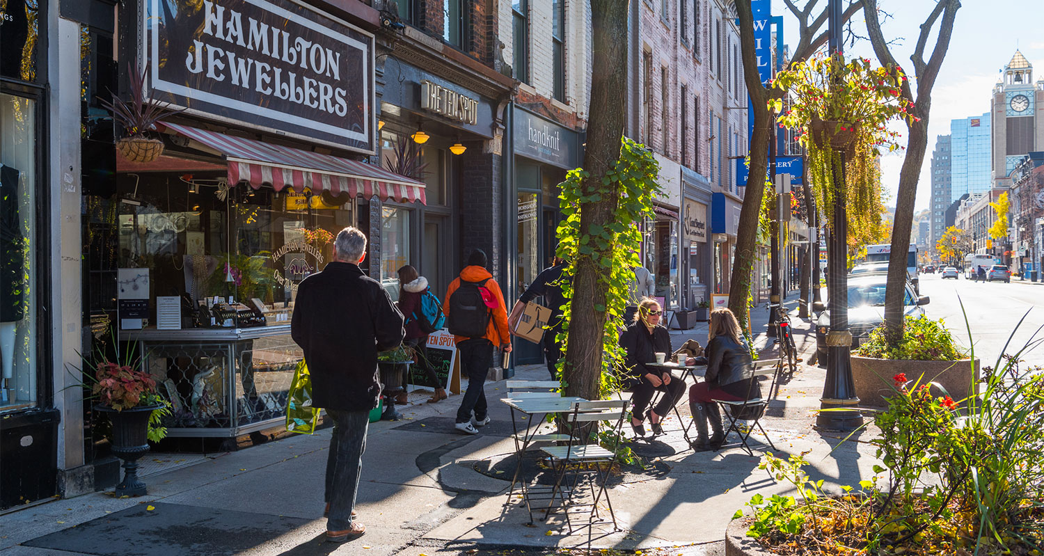 People milling about on a street in Hamilton, Ontario in the fall. Copyright Queen's Printer for Ontario. Image: Ontario Growth Secretariat, Ministry of Municipal Affairs