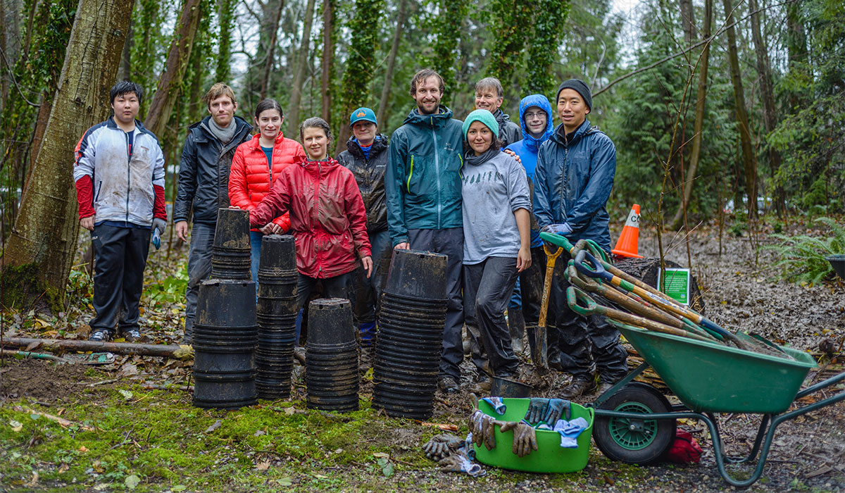 Group of volunteers standing in a watershed during planting activity. Image: Olga Iovlenco