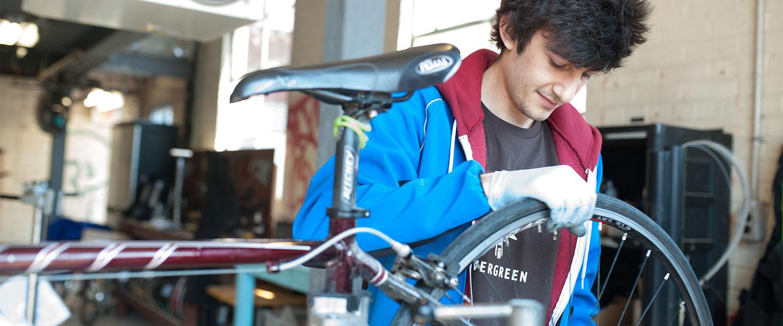 Bike Works staff fixes up a bike.