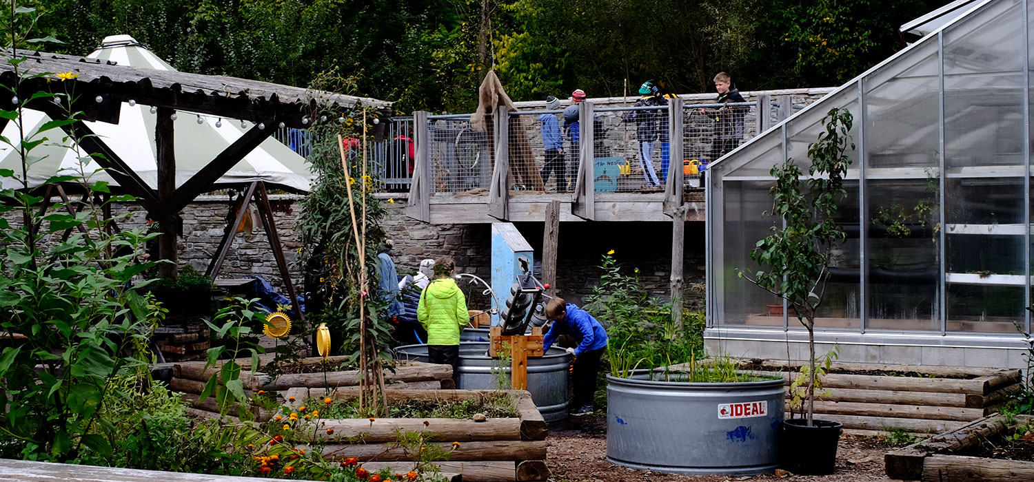 Children play in the newly revitalized Children's Garden at Evergreen Brick Works. Image: {page_banner_credit}