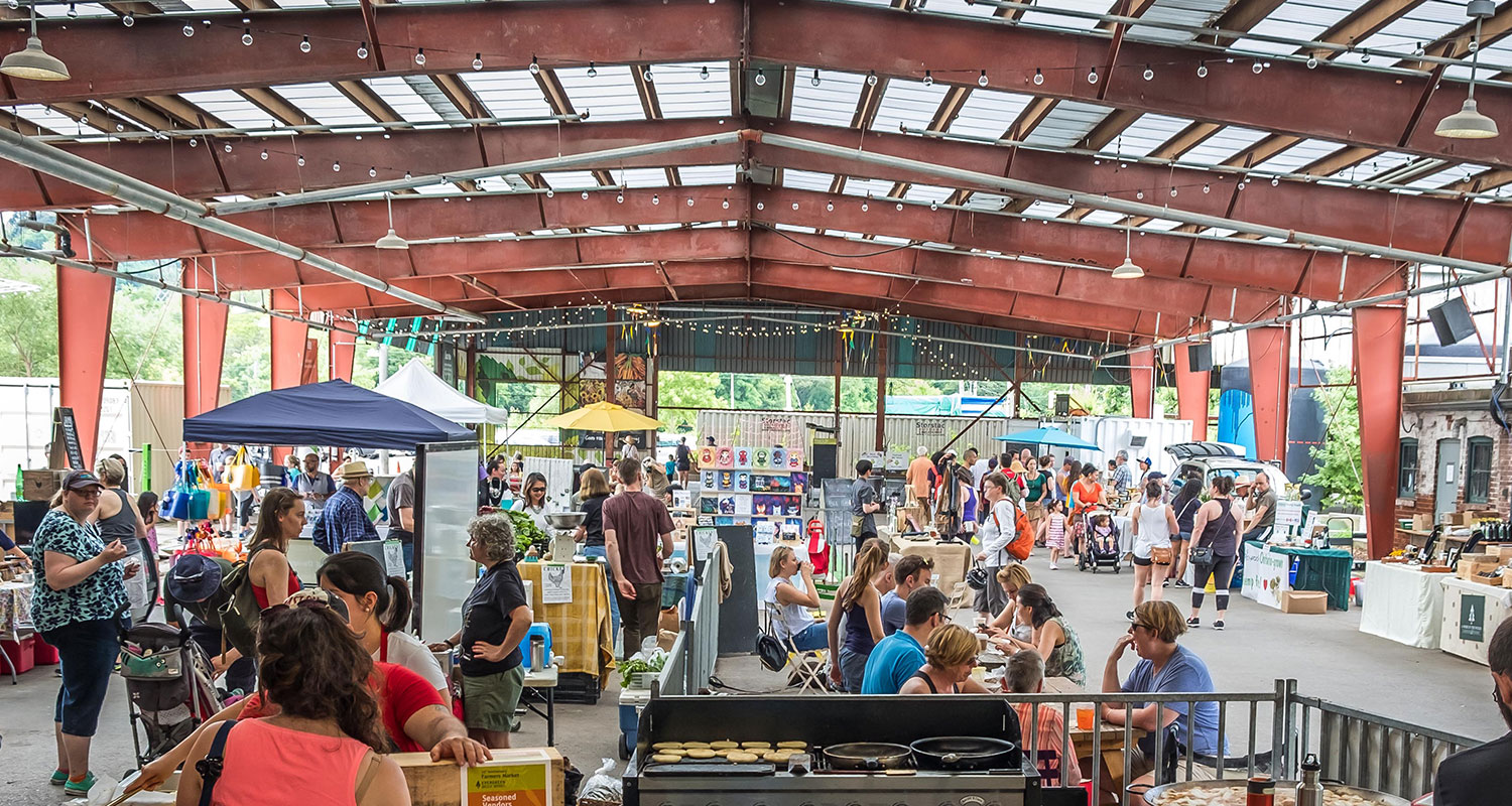 Overhead shot of a bustling Sunday Artisan Market in the Pavilions at Evergreen Brick Works. Image: Len Dobrucki
