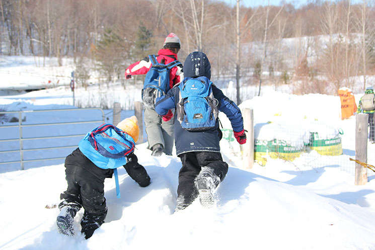 Children playing in snow at Winter Camp / Bill Wilson.