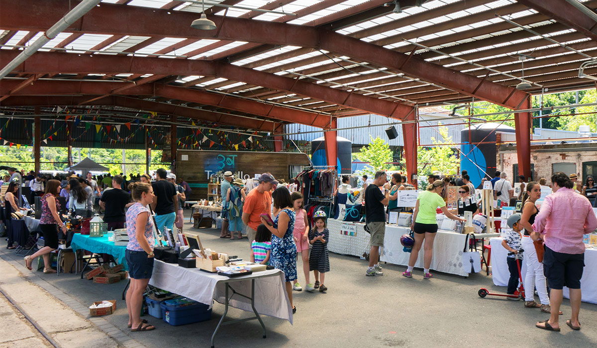 People shopping at the Etsy Market in Evergreen Brick Works' pavilions. Image: Bill Wilson
