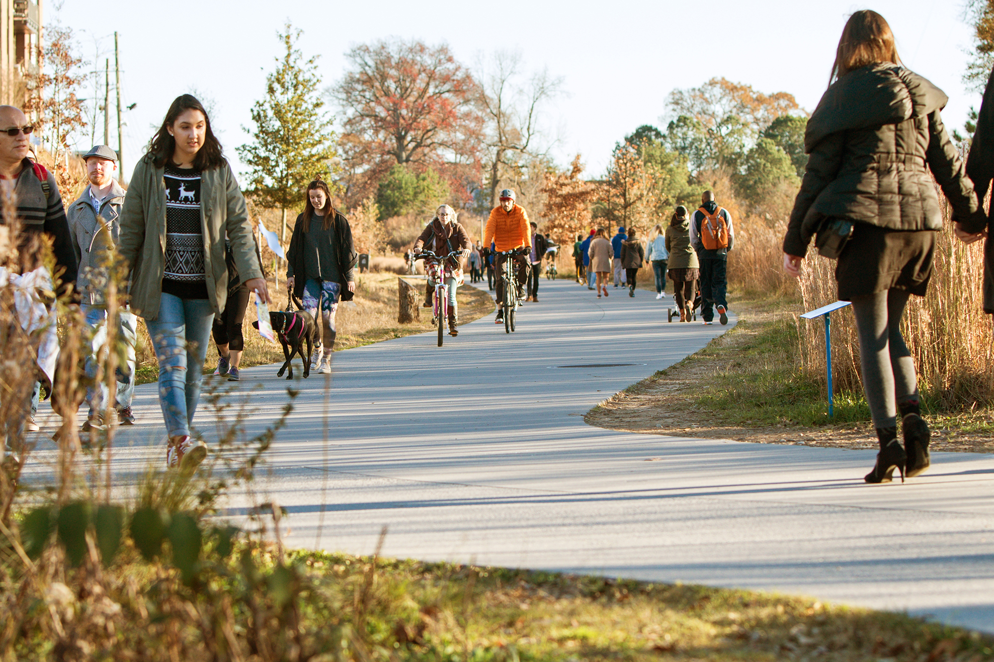 People walk along the Atlanta Beltline Trail.