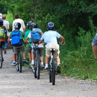 Group of cyclists riding through the trails surrounding Evergreen Brick Works. Image: Mike Derblich