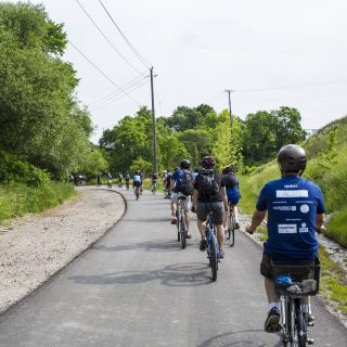 Group of cyclists riding through the trails surrounding Evergreen Brick Works. Image: Geoff Fitzgerald