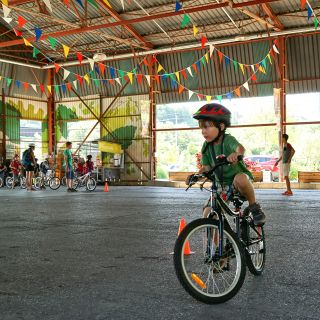 Young child learning to ride a bicycle in the pavilions at Evergreen Brick Works Image: Mark Kremblewski