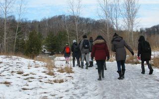 High school students walking through the quarry in winter at Evergreen Brick Works. Image: Arsen Kelesoglu