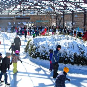 Visitors enjoying a sunny day on Evergreen Brick Works' picturesque skating rink. Image: Mike Derblich