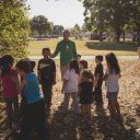 Zack Stevens stands with a group of children at the park. Image: Courtesy City of Kitchener