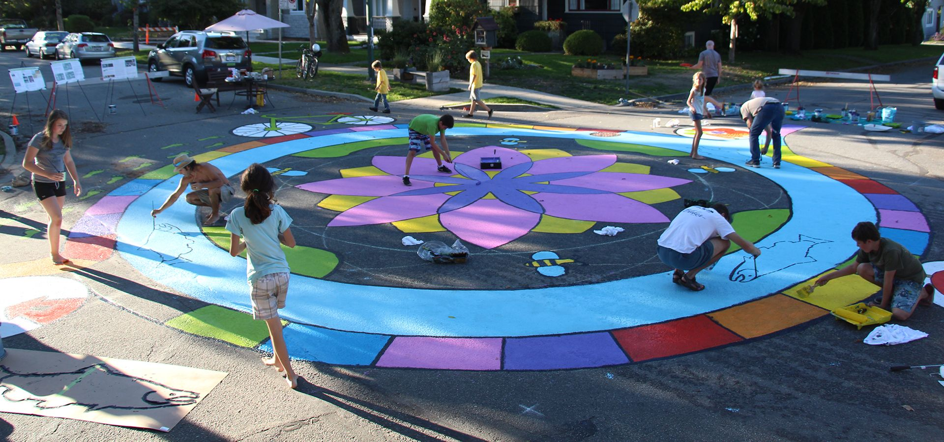 Community creating sidewalk mural Green Bloc Evergreen BC Image Credit: Ellen Li