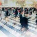 A busy street crossing with blurred people.