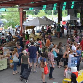 Customers shop at Evergreen's Farmers Market.