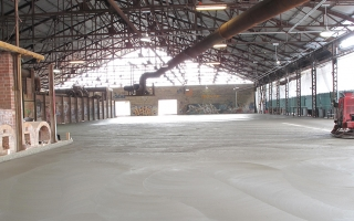 The new raised concrete floor poured in the historic kiln building on the Evergreen Brick Works site.