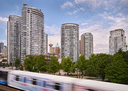 Apartment towers in Vancouver, with the SkyTrain passing in the foreground.