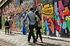 People walking down a laneway.