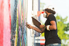 A man painting a mural.