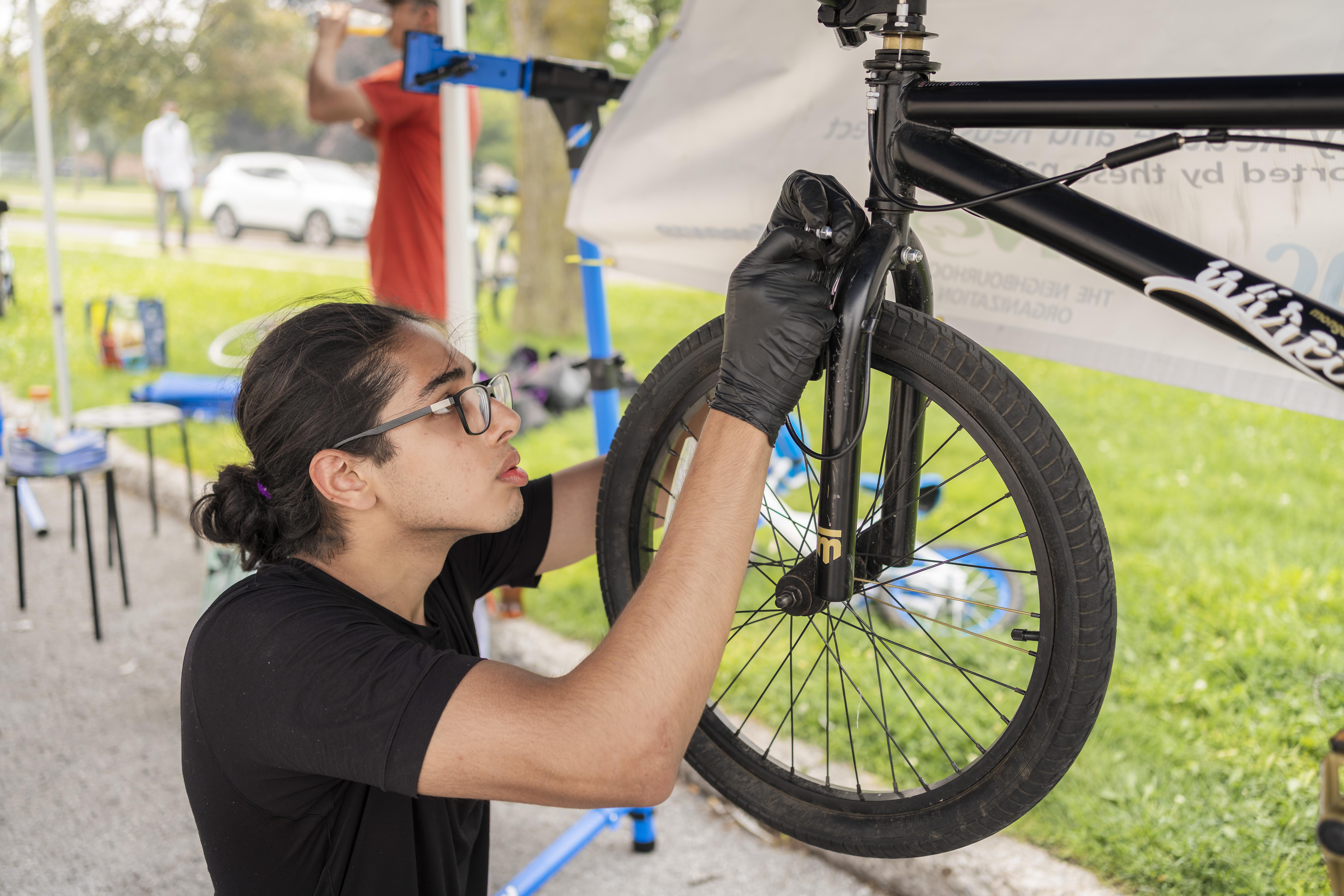 Abdullah fixes a bike at a repair workshop