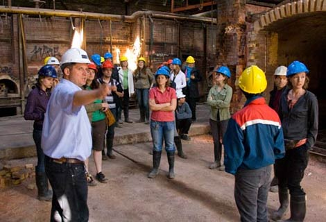 Evergreen staff tour the kiln building