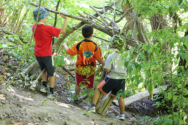 Kids explore their natural surroundings while at Adventure Camp at Evergreen Brick Works.