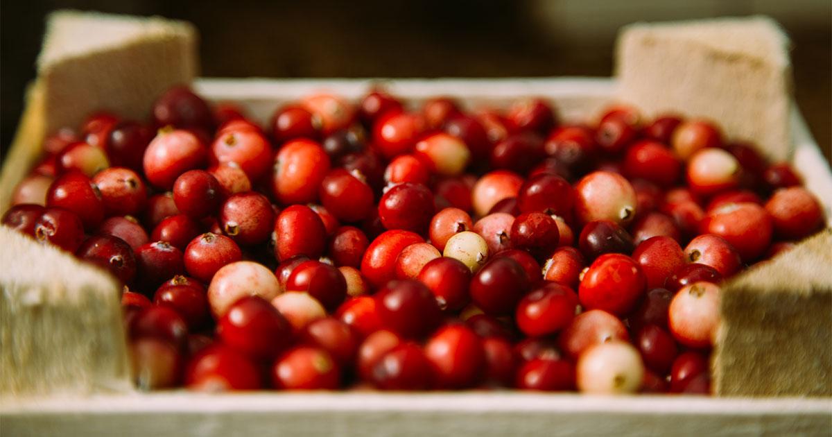 Cranberries in wooden box.
