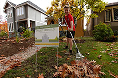 A Project Green Bloc participant raking his front yard. (Photo: Mychaylo Prystupa)