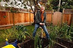 A man working on a garden in a back yard. (Photo: Mychaylo Prystupa)