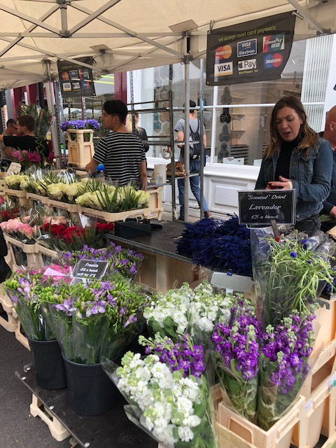 A vendor sells flowers at the Columbia Flower Market in London